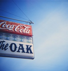 the oak (s myers) Tags: sf sign restaurant cross coke diana medium format cocacola process agfa processed seguin myers staci theoak bluesquare photoworks texastx smyers puppiesofpurgatory rsxii120mmfilmxpro