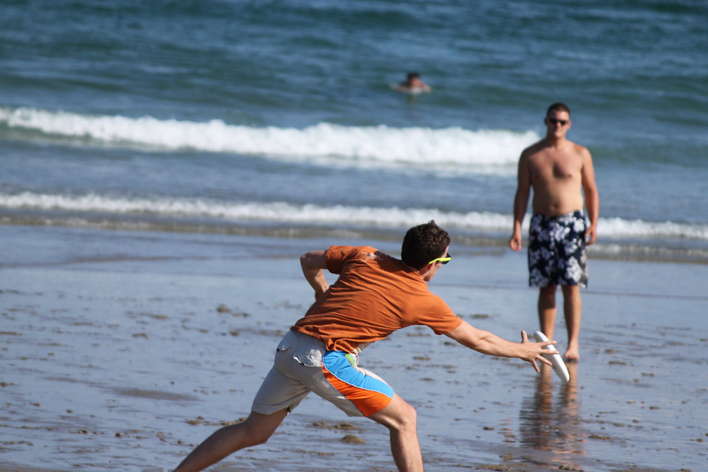Some friends playing frisbee on the beac... by DJHeini, on Flickr