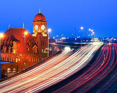 Main Street Station (Ty Johnson Photography) Tags: life road street city railroad bridge light urban usa motion building station skyline architecture night speed train river outdoors photography james virginia nikon highway long exposure cityscape traffic action main trails landmark richmond illuminated historic national transportation interstate 95 rva i95 d3000
