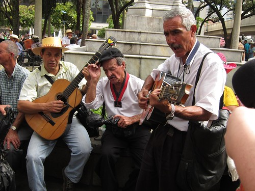 Colombian men sing traditional songs and play their guitars in Parque Berrio.