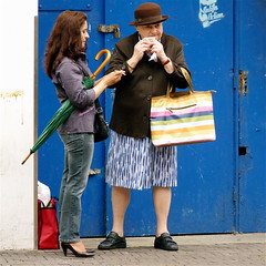 ANTIFA ACTION? (Akbar Simonse) Tags: street people urban woman holland netherlands girl hat umbrella cigarette candid streetphotography denhaag x smoking purse smoker thehague shoppingbag streetshot straat straatfotografie straatfoto hofstijl dedoka akbarsimonse antifaaction