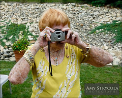 Senior Citizen Taking a Photograph (amycicconi) Tags: camera woman senior photo nikon technology adult jewelry redhead mature elderly digitalcamera freckles aged d200 redhair oldage freckled freckle wrinkled takingapicture seniorcitizen wrinke activesenior amystrycula gettyvacation2010