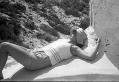 Sunbathing on the farmhouse roof (ReLaBo47) Tags: bw foothills girl farmhouse jupiter sunbathing kiev4 gargano late60s