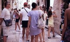 tourist hours (Tanya Skvortsova) Tags: travel summer colour film xpro crossprocessed croatia slide nikonf100 reverse dubrovnik fujivelvia100 epsonv700 july2010 nikkor50mmf14g
