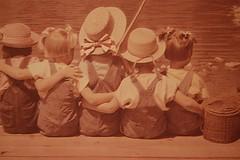 lovely (Izaskun G. Obieta) Tags: girls rio sepia children agua gorro niñas paja ria chil peto sentadas