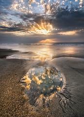 reflection pool (Appalachian Hiker) Tags: beach coast pool tide summer sky clouds texture ocean sunrise rays