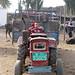 Uyghur boy on a tractor