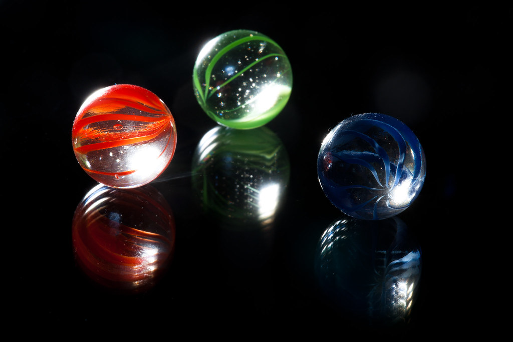 Marbles on shiny surface #3