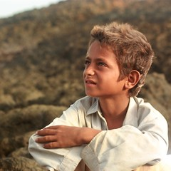 Sunny (take 2) (Ahmad A Karim) Tags: pakistan boy beach kid child sunny arabiansea mubarakvillage bhitkorri