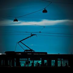 untitled (miemo) Tags: city summer sky people urban silhouette clouds finland lights helsinki europe traffic tram olympus minimal passengers powerlines electricity commuting minimalism ep1 omzuiko100mmf28