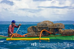 Filipino fisherman with fish traps in Samar (tommyschultz) Tags: people horizontal asia southeastasia philippines bluewater beaches samar 2007 guiuanisland