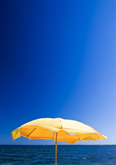 Sunny Days at the Beach (pixbytommy) Tags: blue summer sky lynch water yellow tom umbrella river photography virginia md nikon photographer thomas maryland sunny tommy pixbytommy tomlynchphotographycom