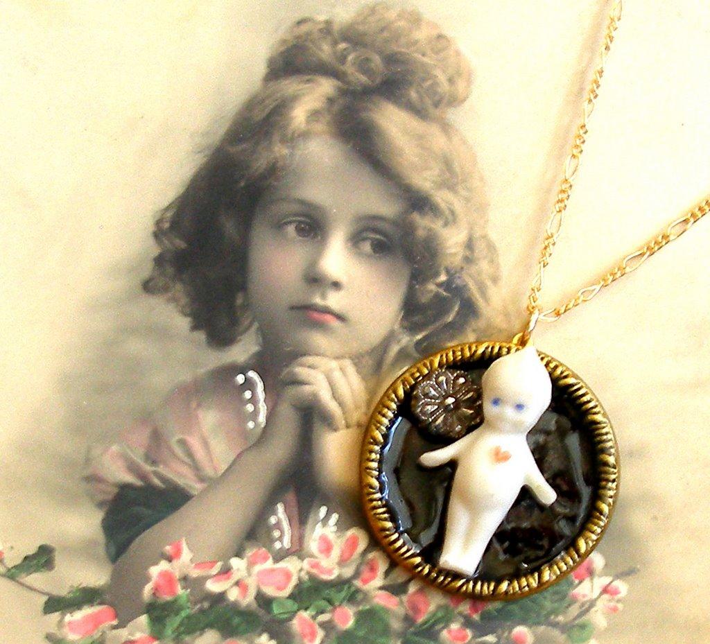 Kewpie Doll, antique button gold necklace.