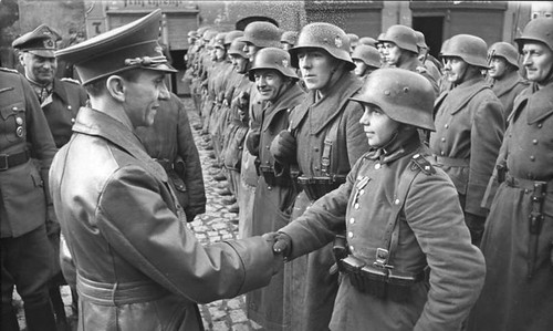 Goebbels awarding a child (Willi Huebner) the Iron Cross -- children were widely recruited during last defense of Berlin in 1945