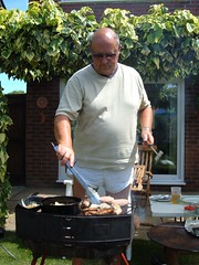 PJ tending the barbecue at home at Nettleham (pj's memories) Tags: male sunglasses garden bbq lincolnshire barbecue shorts nettleham silkyshorts mensshorts
