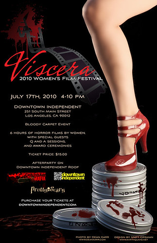 The poster for the Viscera Film Festival. A white, feminine leg in red patent leather heels steps on a stack of bloddy film reels.
