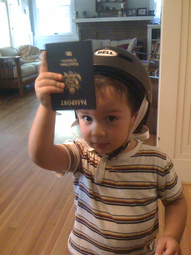 Finn celebrates the arrival of his passport