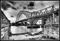 Runcorn Bridge (Hazeldon73) Tags: bridge white black contrast river mono moody stonework bricks transport dramatic walls hdr runcorn widnes halton runcornbridge transportbridge