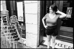 Fixing the hair (_prachi_) Tags: people blackandwhite usa laura girl nikon fuji northcarolina raleigh waitress nikkor neopan400 fm 28mmf28ai 35mmprint raleightimesbar kodaktmaxdeveloper14