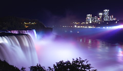 Niagara Falls at Night (sharad_2007) Tags: bridge pink blue sky white ontario canada nature colors night clouds canon river flow eos lights landscapes us colorful stream nightscape purple shot smooth cyan magenta niagara falls best american satin mybest cascade turbulence americanfalls caveofthewinds bestshot mostviewed sharad gushing goatisland strobes turbulent angelhair 40d niagarafallsatnight sharadgupta inshortesttime bestpictureofniagarafalls
