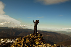 Victory (AlpineEdge) Tags: camping trees sky black mountains girl clouds rocks arms pants wind hiking ridge jacket valley kristen scree larch celebrate fists scramble manningpark frostymountain overnighter windyjoetrail