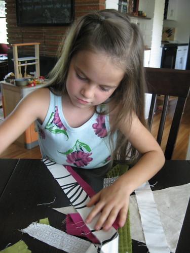 helping mama arrange strips