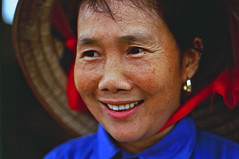 Vietnamese woman worker (rosmee1) Tags: blue red people woman color colour hat female outdoors gold one 1 asia alone places jewelry jewellery vietnam single lone farmer agriculture hanoi solitary strawhat  vitnam    outdoorsthings agriculturepeople