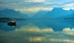 A Blue Morning at Lake McDonald (Jeff Clow) Tags: morning water landscape boat glaciernationalpark lakemcdonald buoyant absolutelystunningscapes pinnaclephotography