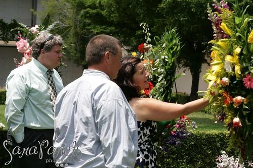 Matt, Mark and Linda take a flower