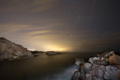 Stars & Clouds Over the Marginal Way (Jeremiah True) Tags: longexposure sky me true fog night canon portland stars rocks glow tide maine 7d photomerge jeremiah atlanticocean 1022mm startrails oldorchardbeach ogunquit marginalway superwide canon7d jtrue