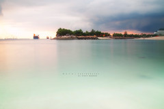 IMG_0765b (si_thu_win) Tags: sea beach water photoshop canon landscapes singapore asia southeastasia cloudy sentosa aasia cs4 500d earthasia flickrtravelaward