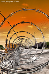 Zone 16 - Circle of Fear (Laveen Photography (aka cyclis451)) Tags: railroad blue arizona orange color green fence tracks az siding chandler variations razorwire cyclist451 laveenphotography chandlerthrowdown