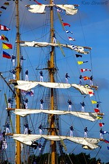 Sailors waving goodbye on the KRI Dewaruci (kees straver (will be back online soon friends)) Tags: ocean sea water colors lines amsterdam sailboat boats boot boat uniform sailing ship action navy sailors bluesky event sail soldiers mast tallship waving rigging darkclouds 2010 vlag heats matroos flages keesstraver nofearofhights thesailorsshow