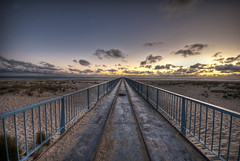 Dangerous rails towards sea - La Salie (Jonas Eberhardt) Tags: sea france beach clouds sand sundown angle steel dunes wide perspective wideangle 100v10f atlantic rails driftingclouds ultra hdr infinite endless stahl atlantik southernfrance weitwinkel wideanglelens endlos ultrawideangle uww ultraweitwinkel weitwinkelobjektiv lasalie 100commentgroup mygearandme mygearandmepremium mygearandmebronze mygearandmesilver