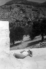 Under the buttresses of the Gargano promontory (ReLaBo47) Tags: bw girl jupiter sunbathing promontory kiev4 gargano