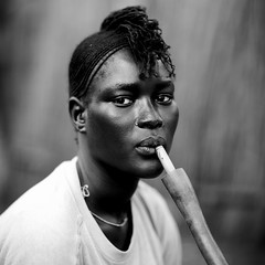 Miss Ariet, Anuak refugee, smoking pipe, in Dima, Ethiopia (Eric Lafforgue) Tags: portrait woman haircut face refugee smoke femme sudan pipe culture tribal tribes tradition ethiopia tribe ethnic dima tribo coiffure ethnology tribu tresses sudanese 4078 ethnie anuak gambella