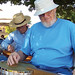 John Farmer and Floyd Cook perform with the Landmark Park Dulcimer Club at the Poplar Head Farmer's Market