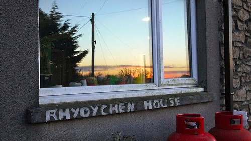 sunset reflected in the kitchen window