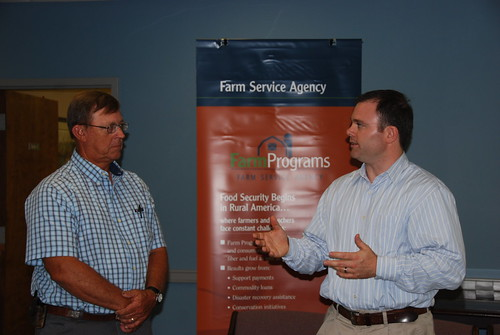 FSA Administrator Jonathan Coppess (right) speaks with cotton farmer Sanford Peeples about the benefits of Recovery Act funding that has supported several FSA programs.