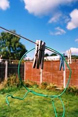 Pegs. (vanillaa) Tags: shadow summer sky sun film grass 35mm wire pentax everyday pegs washing amatuer