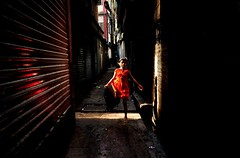 Girl in orange (fahim_123752) Tags: light shadow girl streetphotography candidshots refflection