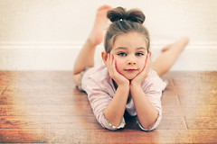 (Rebecca812) Tags: family pink portrait texture beautiful childhood horizontal pose studio kid child sweet innocent daughter ponytail pajamas bun oneperson woodfloor layingdown handunderchin paintthemoon canon5dmarkii familygetty2010 rebecca812 familygetty2011