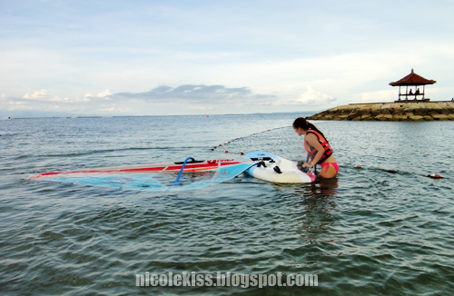 me pushing the windsurf board out