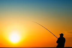 Fishing the sun (Theophilos) Tags: sunset sky fisherman crete rethymno