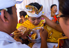 Teenage boy spitting during the tooth filing ceremony, Bali island, Canggu, Indonesia (Eric Lafforgue) Tags: anxiety asia asian bali bali2598 balinese beliefs canggu ceremony clothing colorimage customs dentist family filing groupofpeople headwear hindu hinduism horizontal incisor indigenouspeople indonesia indonesian indonesianculture manusa mesangih pain painful painfully realpeople rite riteofpassage rites ritual spiritual teeth tooth tradition traditional traveldestination baliisland