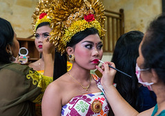 A woman applying makeup to a teenage girl in traditional costume before a tooth filing ceremony, Bali island, Canggu, Indonesia (Eric Lafforgue) Tags: adults asia asian bali bali2128 balinese barong beliefs canggu ceremony clothing colorimage customs family filing hindu hinduism horizontal indigenouspeople indonesia indonesian indonesianculture indoors makeup mesangih realpeople rite rites ritual spiritual toothfiling tradition traveldestination womenonly baliisland