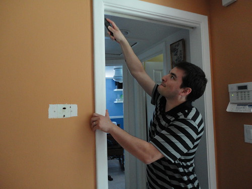 Adam uncaulking the pocket door