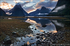 milford sunset (Daniel Murray (southnz)) Tags: park sunset sea newzealand cloud mist mountain snow reflection water rock stone landscape coast scenery national nz sound southisland milford fiord fiordland southnz