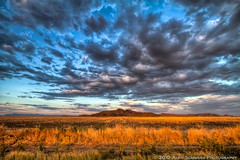 Santan Mountain Range bathed in glorious light (www.alexsommersphotography.com) Tags: blue light sunset summer arizona sky mountain hot southwest clouds canon eos golden desert farm wheat tripod gray az 7d fields rays usm dslr range efs hdr rd 1022 carbonfiber manfrotto santan photomatix gilbertroad cs5 f354 topazadjust wwwalexsommersphotographycom