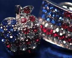 Patriotic Pins (j.towbin ©) Tags: blue red white macro apple colors sparkles focus shiny dof bokeh flag pins redwhiteandblue rhinestones patrioticcolors allrightsreserved© macromondays allrightsreserved©